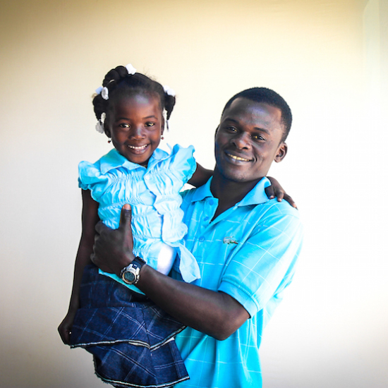 Cenise poses with his daughter Juliette in Haiti